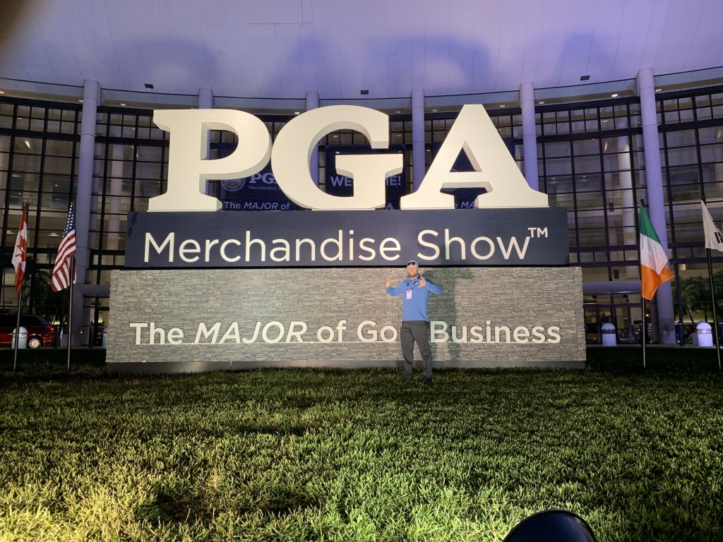 JT Hacker in front of the PGA Merchandising Golf Show Sign